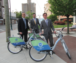 Announcing our new bike share program this morning (but not exactly dressed for a demonstration!)