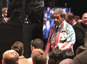 Don King with oversized Trump button.